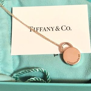 Tiffany & co retired round lock pendant necklace